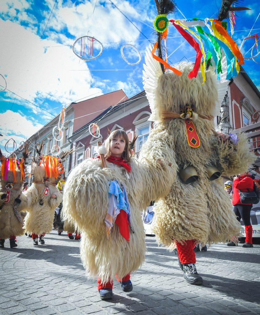 Ptuj, www.visitptuj.eu Seeing large hairy sheep monsters standing up-right and dancing around might sound strange, but don't worry, you're not having a nightmare. These folkloric figures are Kurent and they're meant to look terrifying in order to ward off winter and evil spirits.Taking its name from the Kurent, Kurentovanjeis a carnival like no other, attracting more than 100,000 visitors to the town of Ptuj each spring. www.slovenia.info, Marko Pigac, arhiv Zavod za turizem Ptuj